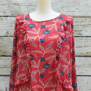 Red floral print blouse with ruffled accent seams.